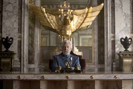 President Snow sitting at his desk