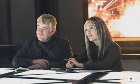 Heavensbee and President Coin talking to Katniss